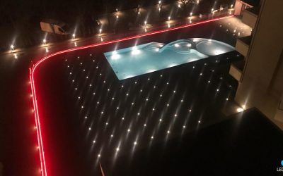 Illuminazione esterno hotel con barre resinate calpestabili